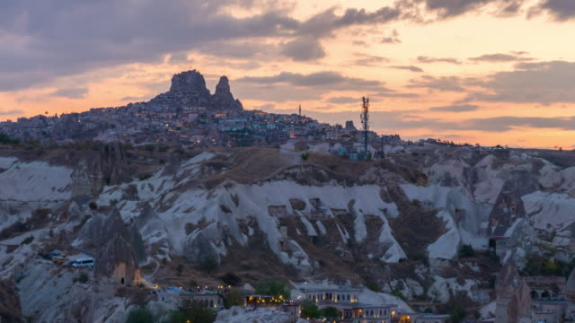 time lapse : day to night city cappadocia in turkey with ancient cave houses near goreme - cliff dwelling stock videos & royalty-free footage