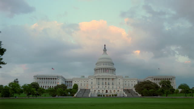 time lapse day to night clouds over Capitol Building / Washington D.C.
