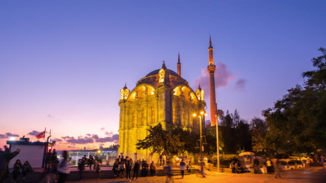 time lapse : day to night crowd people at büyük mecidiye mosque ,istanbul city - blue mosque stock videos & royalty-free footage