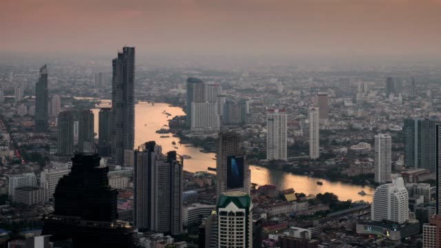 time lapse day to night of bangkok cityscape in sunset time with chao phraya river , movement tilt down - bangkok stock videos & royalty-free footage