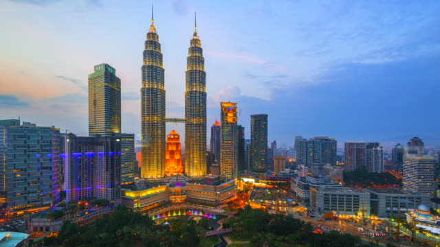 4k time lapse day to night of  elevated view of the petronas twin towers, during the evening, kuala lumpur, malaysia - malaysia stock videos & royalty-free footage