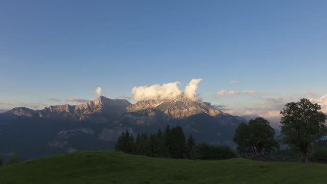 time lapse day to night pan ending on mont blanc - mont blanc stock videos & royalty-free footage
