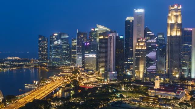 time lapse day to night panoramic aerial view of marina bay and singapore city singapore - vista marina stock videos & royalty-free footage