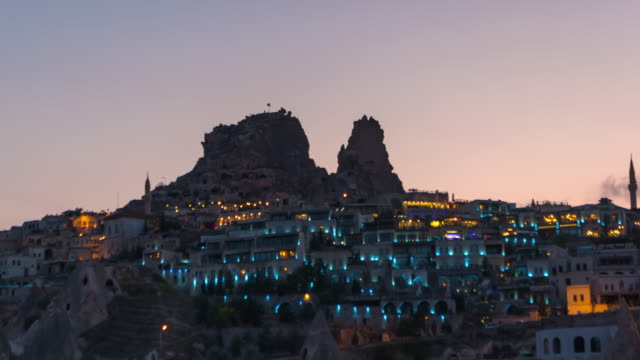 time lapse : day to night panoramic uchisar castle ancient cave houses near goreme, cappadocia, turkey - cliff dwelling stock videos & royalty-free footage