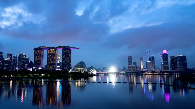 time lapse day to night : skyline of singapore - singapore river stock videos & royalty-free footage