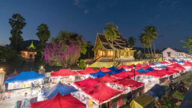 4K Time lapse : Day to night Time lapse in the Night market at Luang Prabang, Laos.