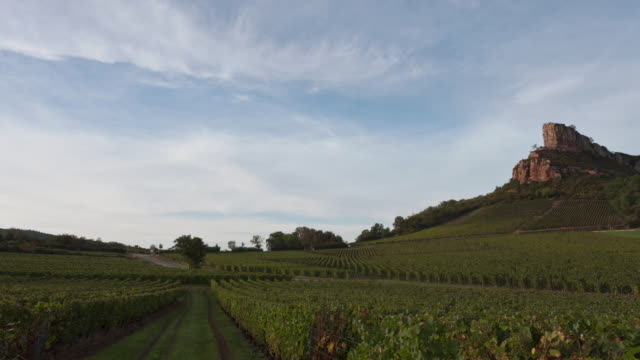 Time Lapse Day to night Track and pan shot of the Rock of Solutré and vineyard of Pouilly Fuissé.