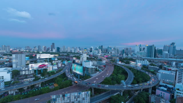 4K Time Lapse : Day to Night traffic highway in building area Business Finance and Industry