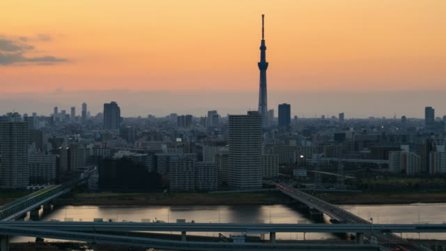 4K Time lapse: Day to night view of Tokyo city with Tokyo Skytree. Zoom out shot