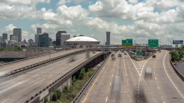 time lapse daytime afternoon cloudy day pontchartrain expressway, new orleans, la. with skyline and mercedes-benz superdome. - mercedes benz stock videos and b-roll footage