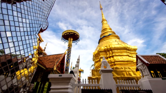 Time lapse dolly sliding gold pagoda and temple moving clounds  in Lampang, Thailand.