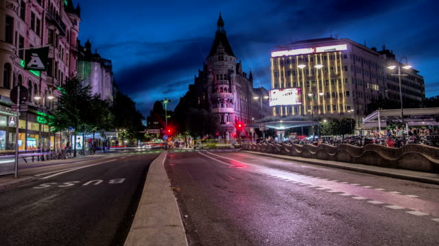 hd time lapse: downtown city street stockholm tilt - billboard stock videos and b-roll footage