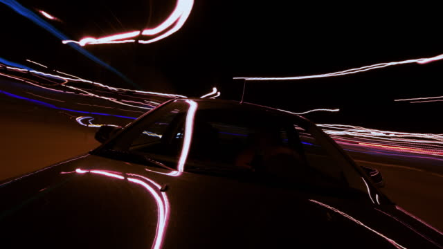 time lapse driving a car at night in the city - bodywork stock videos & royalty-free footage