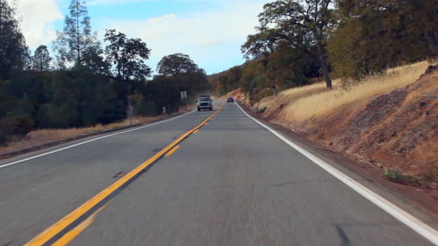 vidéos et rushes de time lapse: driving around the winding road - long