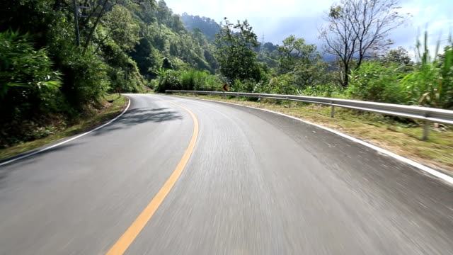 hd time lapse : driving on the empty winding road - empty road stock videos and b-roll footage