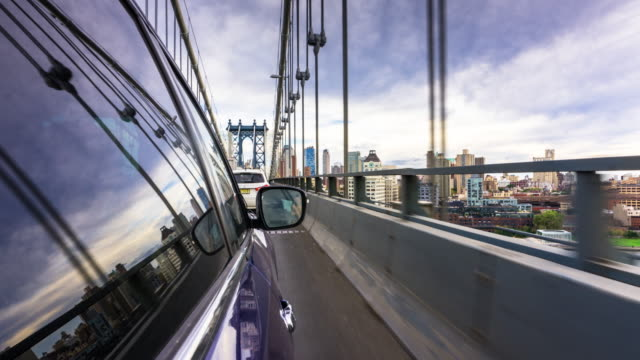 time lapse driving plate - over manhattan bridge - crowdsourced taxi stock videos and b-roll footage