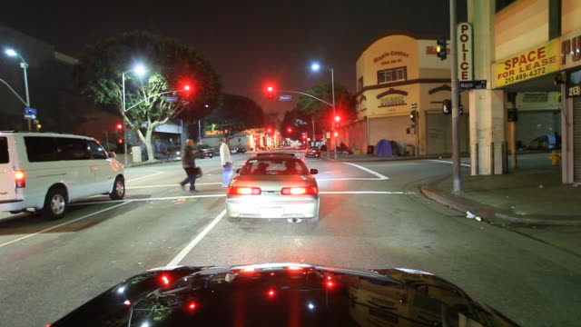 time lapse driving through city streets at night - green light stoplight stock videos and b-roll footage