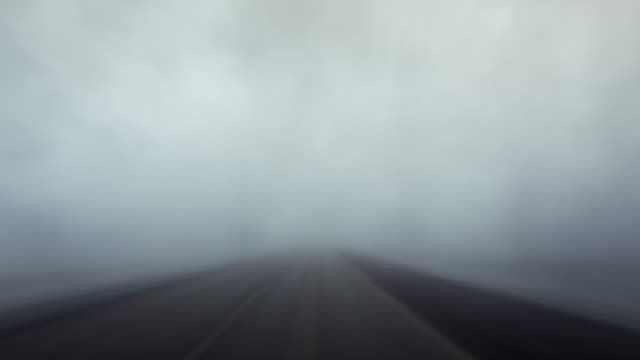 Time lapse driving through fog