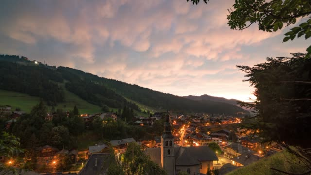 time lapse: dusk in scenic town - rhone alpes stock videos & royalty-free footage