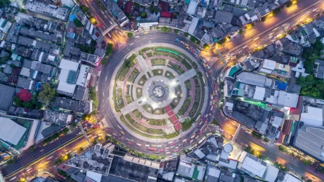4k time lapse dusk to night : aerial top view highway road roundabout or intersection, circle in downtown for transportation, futuristic concept. - roundabout stock videos & royalty-free footage
