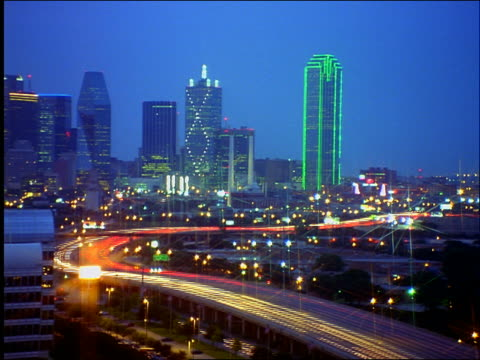 time lapse dusk to night highway traffic with dallas skyline in background - cinematography stock videos & royalty-free footage