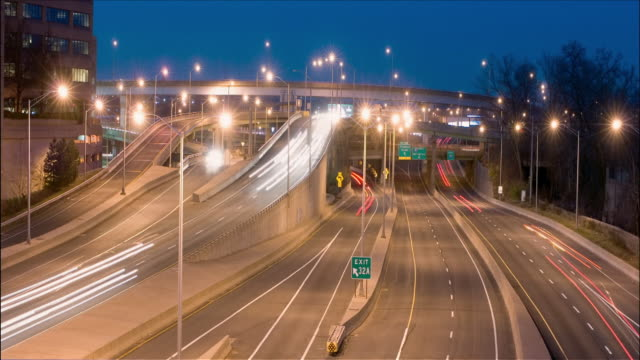 time lapse dusk to night streaks of light from traffic at intersection of interstate 91 and 84 / hartfort, connecticut - connecticut video stock e b–roll