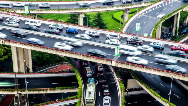 time lapse - elevated roads in shanghai (zoom in) - land vehicle stock videos and b-roll footage