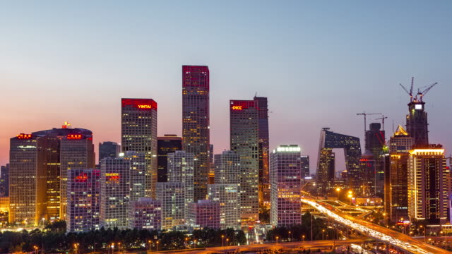 Time Lapse- Elevated View of Beijing Skyline at Dawn, Night to Day Transition (Zoom out)
