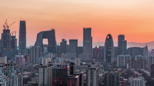 Time Lapse- Elevated View of Beijing Skyline, Day to Night Transition (WS/ Panning)