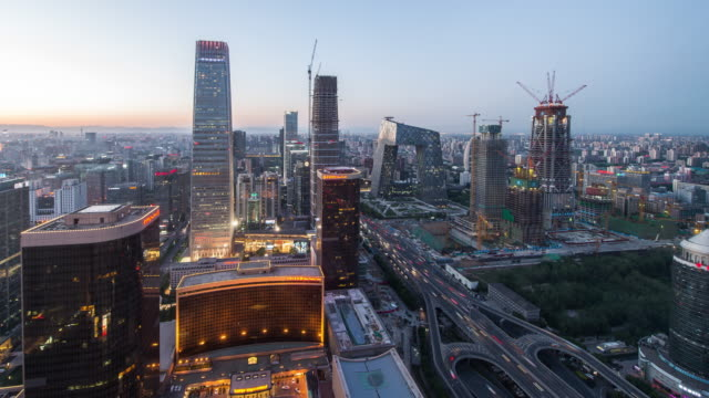 Time Lapse- Elevated View of Beijing Skyline, Day to Night Transition (WS Panning)