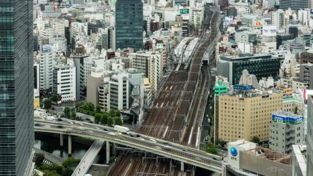 タイムラプス - 東京スカイラインの高い眺め - 列車点の映像素材/bロール