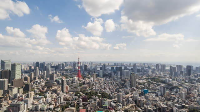 time lapse - elevated view of tokyo skyline (zoom in) - tokyo japan stock videos and b-roll footage