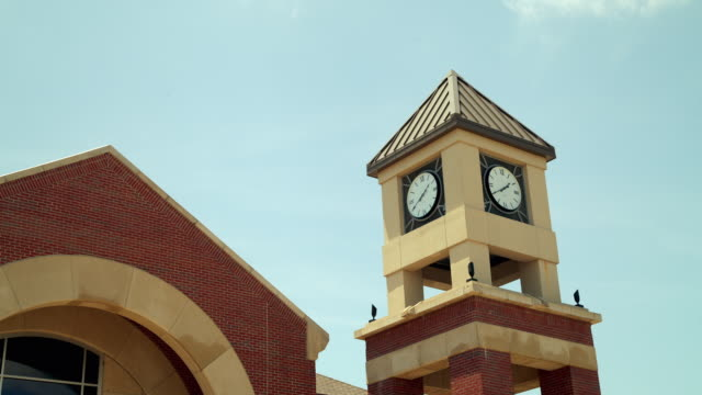 time lapse exterior clock tower at at wichita state univeristy with blue sky and clouds - wichita stock-videos und b-roll-filmmaterial