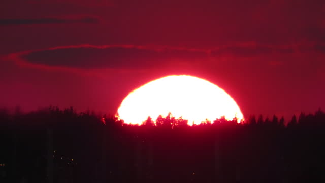 time lapse extreme large sunset over mountains with firery red sky - anacortes stock videos & royalty-free footage