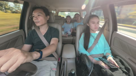 time lapse family travel trip in the car being driven to vacation - car interior stock videos & royalty-free footage