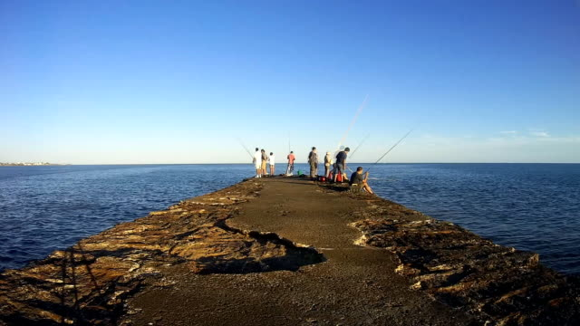 time lapse, fishermen on puertito del buceo, montevideo, uruguay, 2015 - montevideo stock videos & royalty-free footage