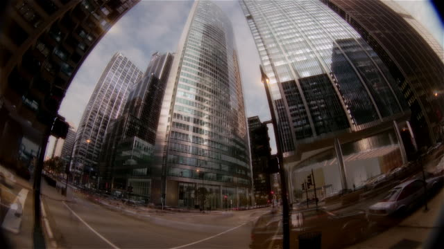 Time lapse fisheye view of buildings and traffic on Wacker Drive / Chicago, Illinois