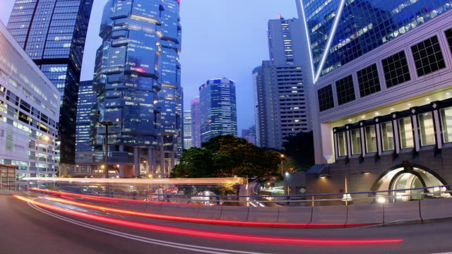 time lapse fisheye view of traffic on hennessy road passing lippo centre and bank of china tower at night / hong kong - bank of china tower hong kong stock videos & royalty-free footage