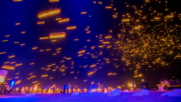 Time Lapse - Floating Sky Lanterns Against the Sky with Blue Color Tone