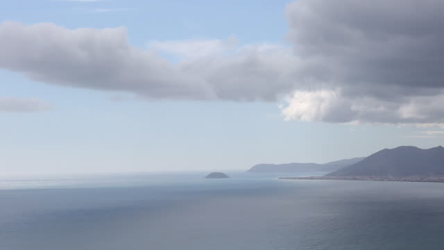 Time lapse fo stormy clouds moving over mediterranean coastline