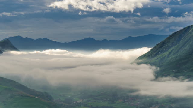 time lapse fog mist cover on sa pa village and fade out flow,vietnam - fade out stock videos & royalty-free footage