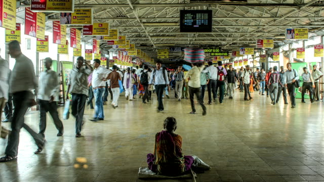 Time lapse footage of commuters on an overbridge of a railway station