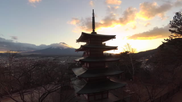 4k time lapse footage of mount fiji with the chureito pagoda in the foreground - pagoda stock videos & royalty-free footage