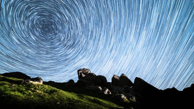 time lapse footage of star trails creating a swirling night sky around the north star on september 06 2019, in dartmoor, united kingdom. - solitude stock videos & royalty-free footage