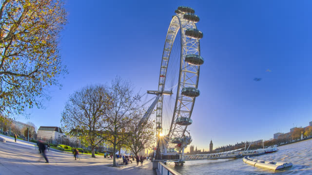 time lapse footage of sunset over london eye observation wheel in london. - millennium wheel stock videos and b-roll footage