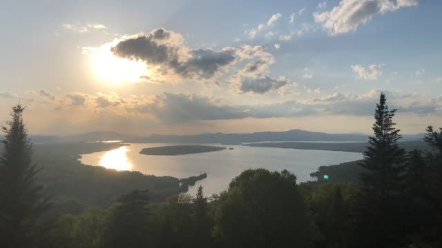stockvideo's en b-roll-footage met time lapse footage of the sky above lake mooselookmeguntic near rangeley, maine usa during summer - wildernis