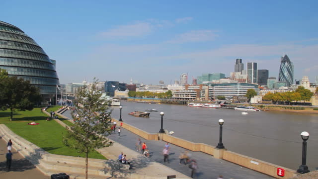 time lapse footage of the tourists activity on the riverbank by the city hall in london. - gla building stock videos & royalty-free footage