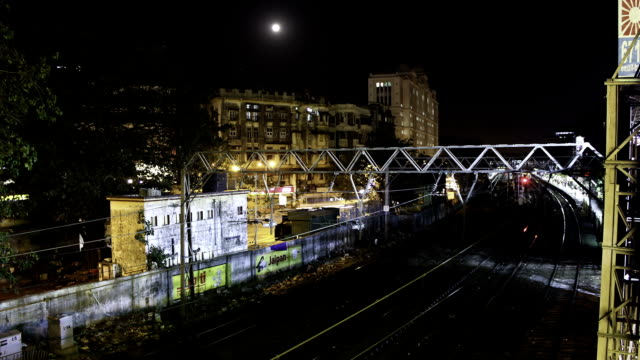 time lapse footage of trains from overbridge - night stock videos & royalty-free footage