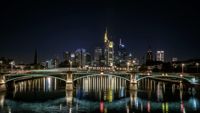 time lapse: frankfurt city is behind  stone bridge along main river, germany at night - frankfurt main stock videos & royalty-free footage