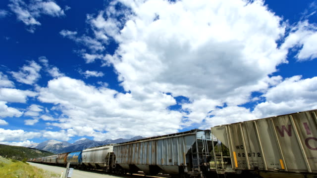 time lapse freight train northwest wilderness jasper alberta - storage tank stock videos and b-roll footage